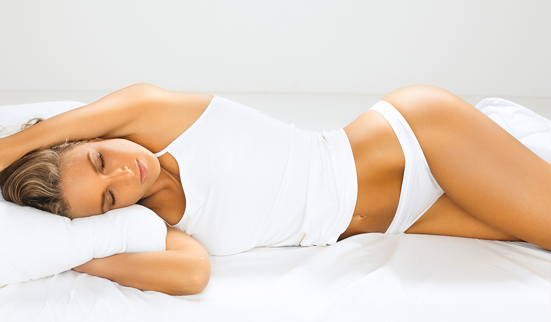 """Featured image for """"When Can You Sleep on Your Side After Breast Augmentation?"""""""